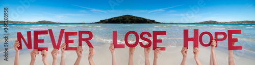 Obraz People Hands Holding Colorful English Word Never Lose Hope. Ocean And Beach As Background - fototapety do salonu