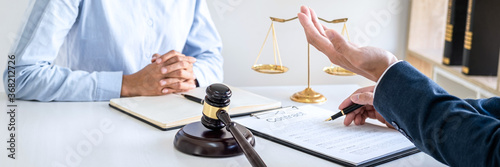 Obraz na plátně Male lawyer and businesswoman working and discussion having at law firm in offic