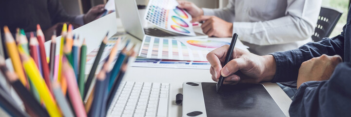 Two creative graphic designer working on color selection and color swatches