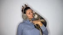 A Woman With Reindeer Earmuffs...
