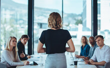 Female Business Leader Conducting A Meeting