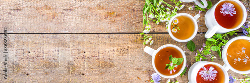 Obraz Different herbal tea set. Various  cups with organic herbal, flower tea - camomile, chicory, melissa mint, lavender. Organic natural drinks concept. Health and immunity care beverages - fototapety do salonu