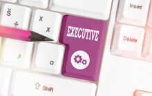Writing Note Showing Executive...