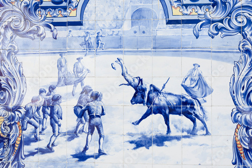 Fotografie, Obraz Typical Portuguese Azulejos depicting bullfight on the facade of Santarem market