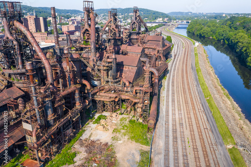 Valokuva Aerial of abandoned steel factory in Pennsylvania with train tracks and a river alongside