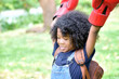 African American little boy play Boxing gloves at nature park.