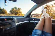 Woman's Legs Out Of The Car Wi...