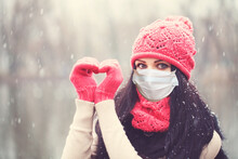 Christmas Woman In Medical Protective Face Mask Making Heart, Winter Portrait