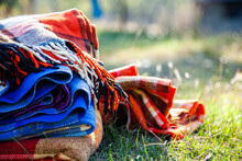 Pile Of Blankets On Grass In W...