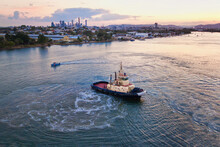 Tugboat Ferry At Sunrise On Th...