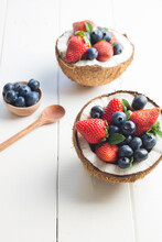 Halved Coconuts Filled With Berries