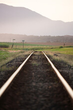 Cane Train Tracks With Mountains In Background
