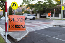 Children Crossing Sign On Road...
