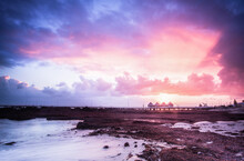 Distant View Of Busselton At Sunrise With Sun Rays Shining Through