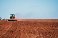 Tractor Plows Red Dirt Ready For Cropping.