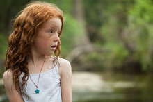 Young Redheaded Girl By The Ri...