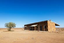 Old Building In Desert Landscape