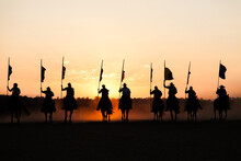 Line Of Silhouetted Horses And...