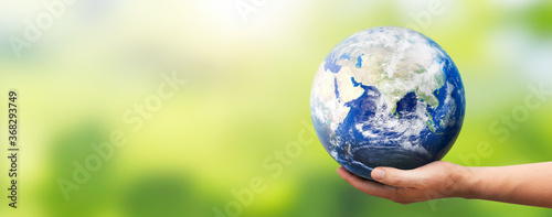 Hand holding Earth globe. World environment day. Elements of this image furnished by NASA