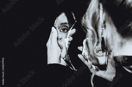 Tablou Canvas Retro girl and broken self-image mirror, black and white portrait