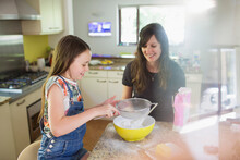 Mother And Daughter Baking In ...