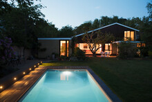 Home Showcase Exterior With Illuminated Swimming Pool At Night