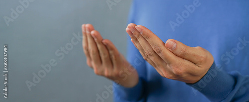 Obraz close up adult muslim prayer man hand praying at mosque for religion and culture concept - fototapety do salonu