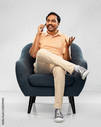 people, technology and communication concept - happy smiling young indian man si Fotobehang