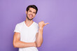 Portrait of his he nice attractive cheerful cheery glad guy freelancer showing copy space advice new novelty isolated over bright vivid shine vibrant lilac violet purple color background