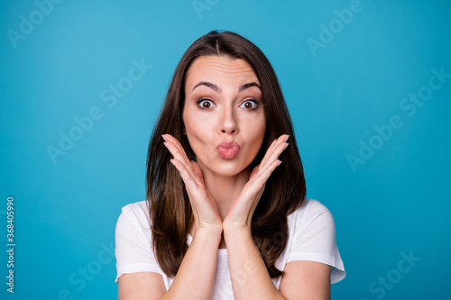Closeup photo of attractive charming lady send air kisses boyfriend handsome macho guy coquettish girlish person arms near cheekbones wear casual white t-shirt isolated blue color background