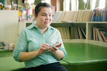 Asian Young Blind Person Woman Using Smart Phone With Voice Accessibility For Persons With Disabilities In Creative Workplace.