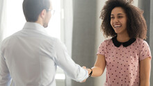 Executive Shaking Hand Of Successful Diverse Smiling Female Employee, Team Leader Congratulating Businesswoman With Promotion, Business Achievement, Thanking For Good Work Results, Horizontal Photo