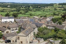 A View Across The Village Of Middleham, Yorkshire, England To Rural Farms.