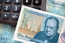 British Currency. The New UK Polymer Five Pound Note With A Calculator.