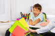 canvas print picture - Boy with autism spectrum disorder throw textbooks and books from table in negative expression behavior sitting near teacher