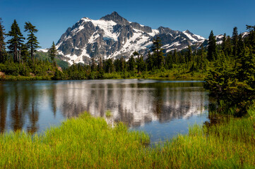 Picture Lake with Mount Shuksan in the Background. This Lake is the centerpiece of a strikingly beautiful landscape in the Heather Meadows area of the Mt. Baker recreation area.