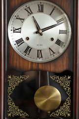 Antique wall pendulum clock