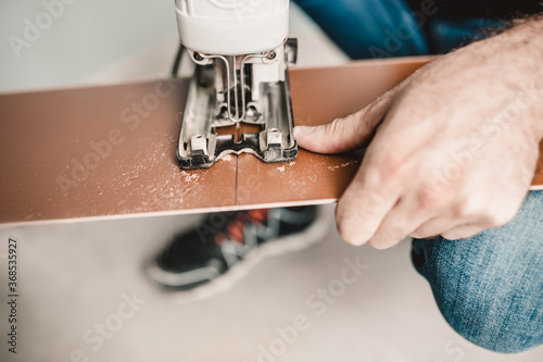 Valokuvatapetti Floating flooring technology for laminate panels - trimming and assembling panel
