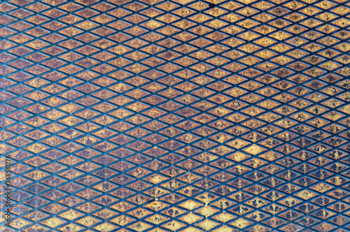 metal grunge background covered with abraded yellow paint, rust Canvas Print