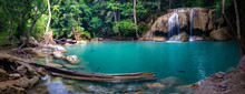 Panorama Photo Of Erawan Waterfall In The Tropical Jungle Surrounded By A Natural With Turquoise Clear Fresh Water And Green Forest In Kanchanaburi, Thailand.