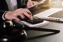 Lawyer Or Accounting Department Writes A Note And Uses A Calculator To Calculate Expenses - Income. At Office Lawyer.