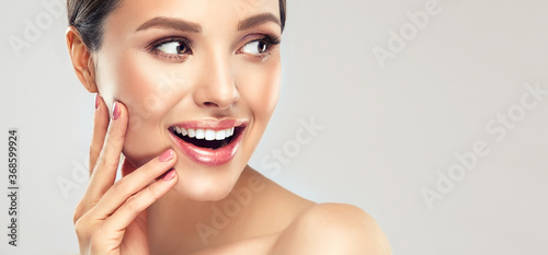 Fotografija Beautiful young woman with clean fresh skin on face