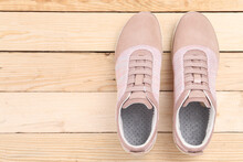 Sneakers On Wooden Background With Copy Space. Top View. Vintage Effect.
