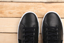 Sneakers On Wooden Background ...