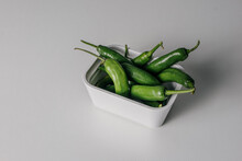 Hot Green Peppers In A White B...