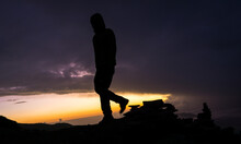 Silhouette Of A Man Stepping D...