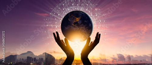 Fototapeta Woman hands holding earth with circle global network connection and data exchanges worldwide exposure on city and mountain sunset background.Elements of this image furnished by NASA obraz