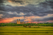 Victoria, KS USA - Panorama View Of The Midwest Wheat Field Prairie And Cathedral Of The Plains In Victoria Kansas USA Prairie In Sunset Sky Clouds