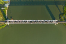 Aerial View Of Railway Bridge Over The River. Top View Of Railroad From Drone.