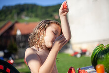 Boy With Long Hair Eat Watermelon Stock Photo